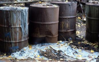 Cause of the disaster - chemicals leaking out of barrels . Toxic stew